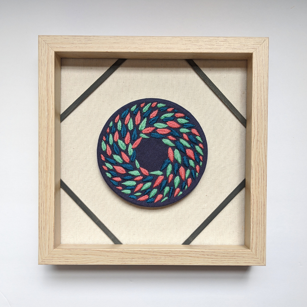 Multi Colored Wreath on Blue Linen